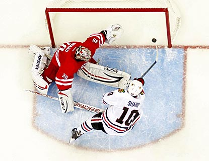 Chicago's Patrick Sharp bests Carolina's Cam Ward to score the deciding goal in the shootout.  (USATSI)