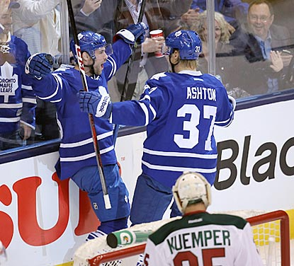 Toronto center Trevor Smith (left) celebrates his first-period goal with right wing Carter Ashton.  (USATSI)