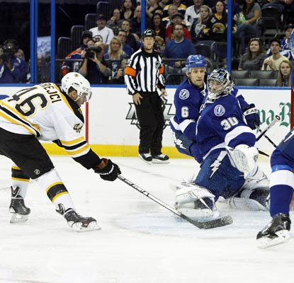 David Krejci beats previously unbeaten Lightning goalie Ben Bishop for a goal in Boston's blowout win.  (USATSI)
