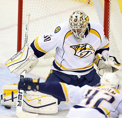 Preds netminder Carter Hutton makes one of his 37 saves against the Jets en route to his first NHL win. (USATSI)