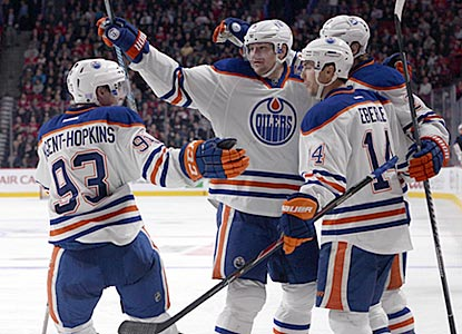 Jeff Petry (center) celebrates with teammates after his goal in the third period puts the Oilers ahead to stay.  (USATSI)