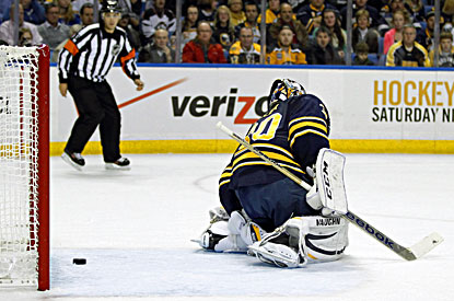 Sabres goalie Ryan Miller gives up a first-period goal to Boston's Milan Lucic. (USATSI)