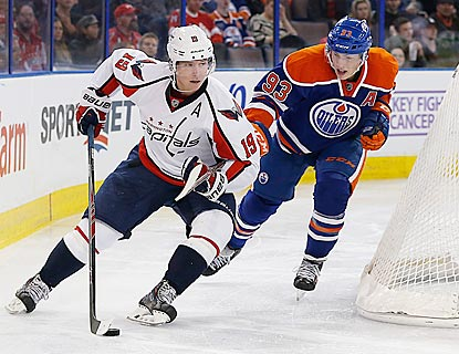 Nicklas Backstrom, one of eight Capitals to register a point in this game, is pursued by Ryan Nugent-Hopkins.  (USATSI)