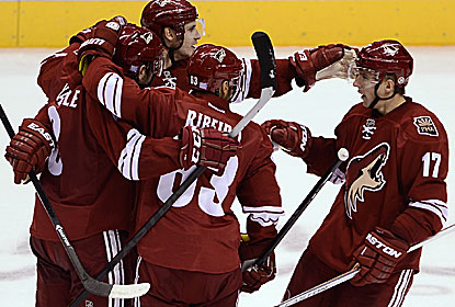 The Coyotes soak in the win, which comes on the strength of four goals and three assists from their defensemen. (USATSI)