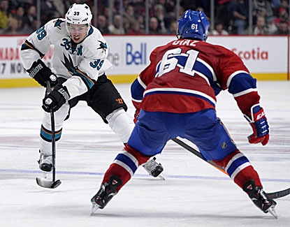 San Jose's Logan Couture works the puck against the Canadiens. Couture scores both of the Sharks' goals. (USATSI)