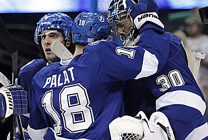 Ondrej Palat and goalie Ben Bishop celebrate the win, which gives the Lightning a 5-2 record to end their homestand. (USATSI)