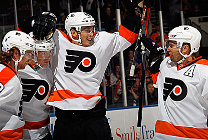 Vinny Lecavalier (center) records his seventh career three-goal game in the Flyers' biggest offensive outing of the season. (Getty Images)