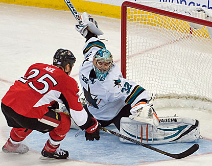 Alex Stalock stops a shot by Ottawa's Chris Neil, one of 38 saves by the San Jose goalie in his first start. (USATSI)