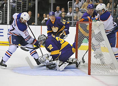 Kings goaltender Jonathan Quick thwarts Oilers center Boyd Gordon during the third period.  (USATSI)