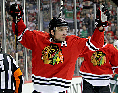 The Blackhawks' Patrick Sharp celebrates his first-period goal against the Wild.  (USATSI)