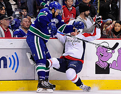 Vancouver's Darren Archibald puts a big hit on Capitals defenseman Mike Green in the Canucks' 3-2 win. (USATSI)