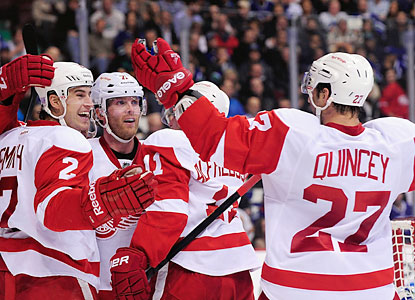 Daniel Alfredsson (11) celebrates with Brendan Smith (2) and Kyle Quincey (27) after scoring his goal. (USATSI)