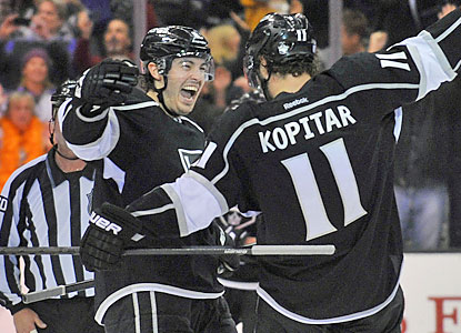 Anze Kopitar delivers the winning goal in overtime to help the Kings complete their rally against the Sharks. (USATSI)