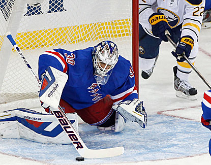 Henrik Lundqvist makes one of his 29 saves against the Buffalo Sabres, who do not get the puck past the goalie. (USATSI)
