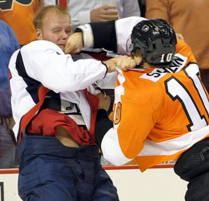 A melee breaks out once the score reaches 7-0 in the third period, ending up in a total of 114 total penalty minutes.  (USATSI)
