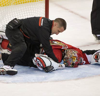 Craig Anderson suffers a scary injury in overtime after a collision with Valeri Nichushki.  (USATSI)