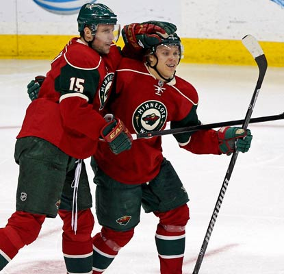 Dany Heatley (15) and Mikael Granlund score for the Wild in a dominant 4-0 shutout win over the Devils.  (USATSI)
