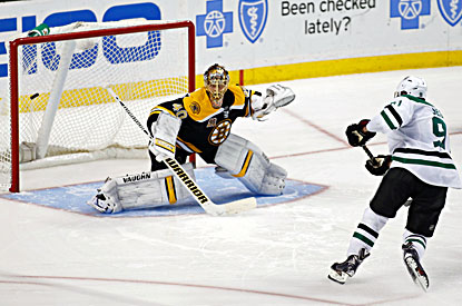 Tyler Seguin (right) scores on Bruins goalie Tuukka Rask during the shootout.  (USATSI)