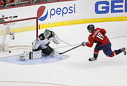 Nicklas Backstrom scores the only goal in the shootout to secure the Capitals' fourth straight home win. (USATSI)