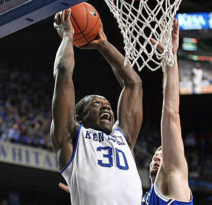 Kentucky's Julius Randle scores 15 of his 23 points in the second half against UNC-Ashville. He also grabs 15 boards. (USATSI)
