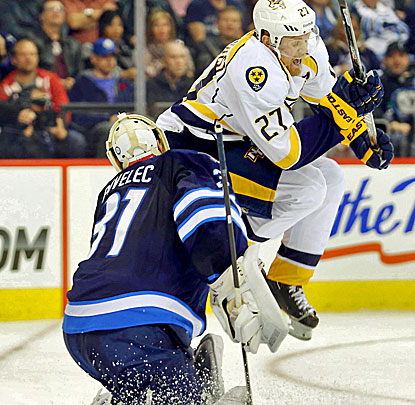 Nashville's Patric Hornqvist interferes with Jets goalie Ondrej Pavelec as he makes one of his 41 saves. (USATSI)