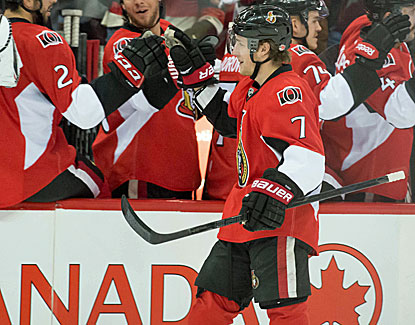 Kyle Turris gets some love from the Senators' bench and he earned it, coming through with a goal and an assist. (USATSI)