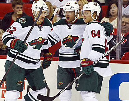 Minnesota's Jason Pominville (center) celebrates with teammates after an early goal. He later wins the shootout. (USATSI)