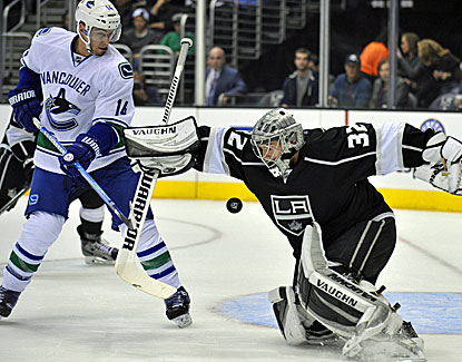 Jonathan Quick stops the shot of Alex Burrows, one of 25 saves for the Kings goalie against Vancouver (USATSI)