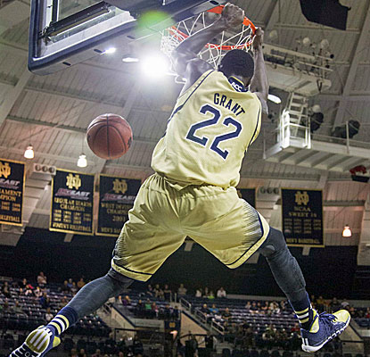 Notre Dame senior guard Jerian Grant dunks home two of his 15 points against Stetson. (USATSI)