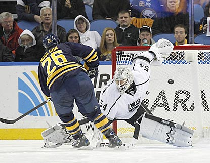 Matt Moulson puts the puck past Kings backup goalie Ben Scrivens to end Buffalo's near-record season-opening home drought.  (USATSI)