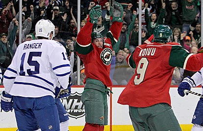 Minnesota left wing Zach Parise (center) exults after scoring to tie the game late in third period.  (USATSI)