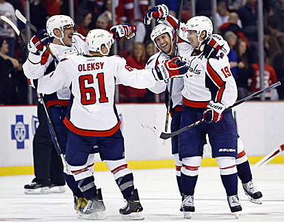 Nicklas Backstrom celebrates with his teammates after scoring the game-winner against Detroit. (USATSI)