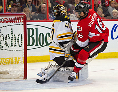 Ottawa's Clarke MacArthur gets up close and personal with Bruins goalie Tuukka Rask, as the Sens come back to defeat Boston. (USATSI)