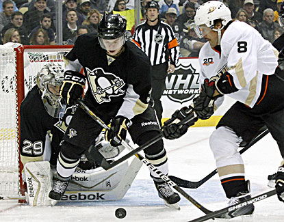 Goalie Marc-Andre Fleury and Pens defender Olli Maatta thwart a shot attempt for the Ducks' Teemu Selanne. (USATSI)