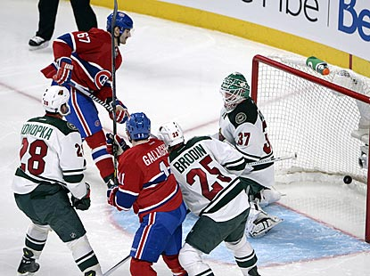 Max Pacioretty (67) scores three goals in succession during the second period, including this shot past Josh Harding.  (AP)
