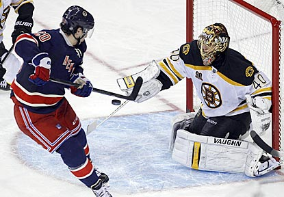 Boston's Tuukka Rask makes a save in front of New York left wing Chris Kreider during the third period.  (USATSI)