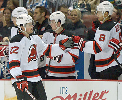 The Devils bench congratulates Eric Gelinas, who scores a power-play goal in the first period of action. (USATSI)