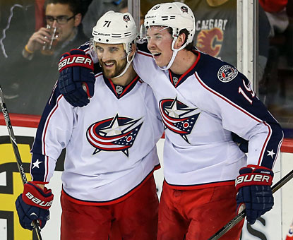 Nick Foligno (left) and the Blue Jackets send the Flames to their sixth consecutive home loss.  (USATSI)