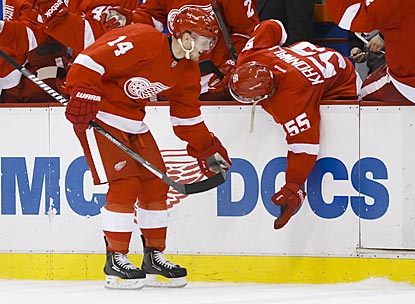 Gustav Nyquist gets a low-five from Niklas Kronwall after scoring his second goal, which turns out to be the winner.  (USATSI)