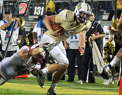 UCF Knights quarterback Blake Bortles completes 21 of 30 passes for 335 yards and no interceptions. (USATSI)