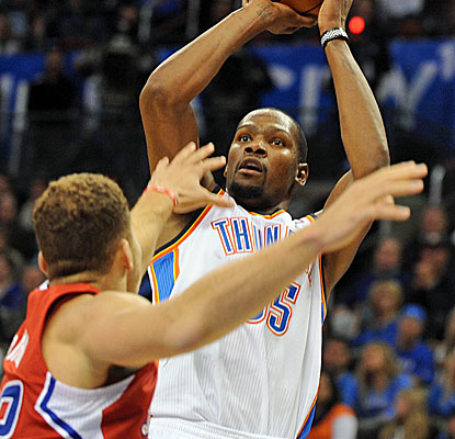 OKC's Kevin Durant goes up for two of his 28 points and there is very little Blake Griffin can do about it. (USATSI)