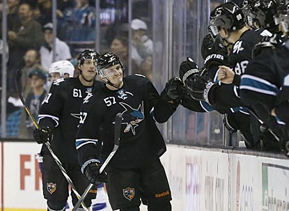 Tommy Wingels meets the Sharks welcoming committee after scoring his second goal of the game, which pushes the lead to 3-0.  (USATSI)