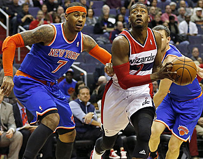 Washington point guard John Wall blows by Carmelo Anthony for two of his 31 points against the Knicks. (USATSI)