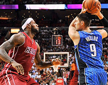 Not only does LeBron James hit the winning shot, he shows his versatility by clamping down on center Nikola Vucevic. (USATSI)