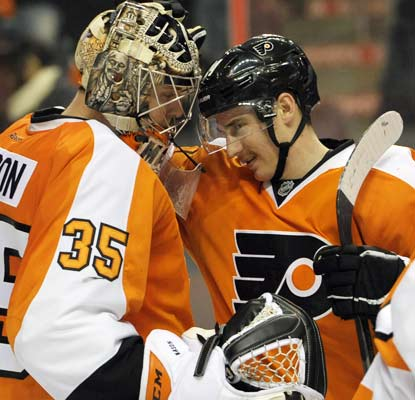 Matt Read (right) chips in with two goal and goalie Steve Mason (left) stops 36 shots to get the Flyers' record to 10-10-2.  (ULive)