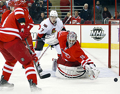 Carolina goalie Cam Ward makes the save, one of his 35 stops against the Senators, who manage just one goal. (USATSI)