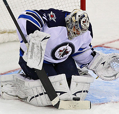 Ondrej Pavelec makes the stop for Winnipeg, one of his 25 saves against the New Jersey Devils. (USATSI)