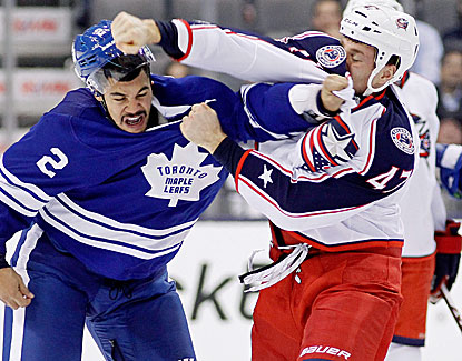 Columbus' Dalton Prout lands a punch on Mark Fraser. The Maple Leafs did not land anything against the Blue Jacket. (USATSI)