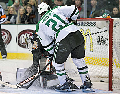 Antoine Roussel scores one of his two goals against Ducks goalie Jonas Hiller in the Stars' win. (USATSI)