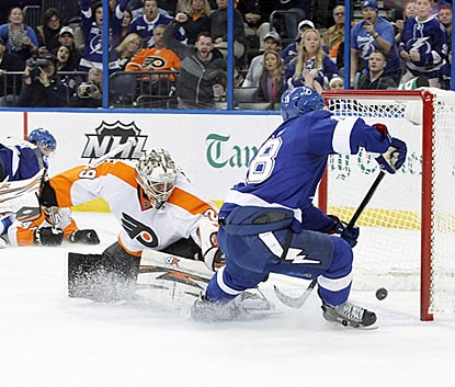 Tampa Bay's Ondrej Palat puts the puck past Philadelphia's Ray Emery during the second period.  (USATSI)